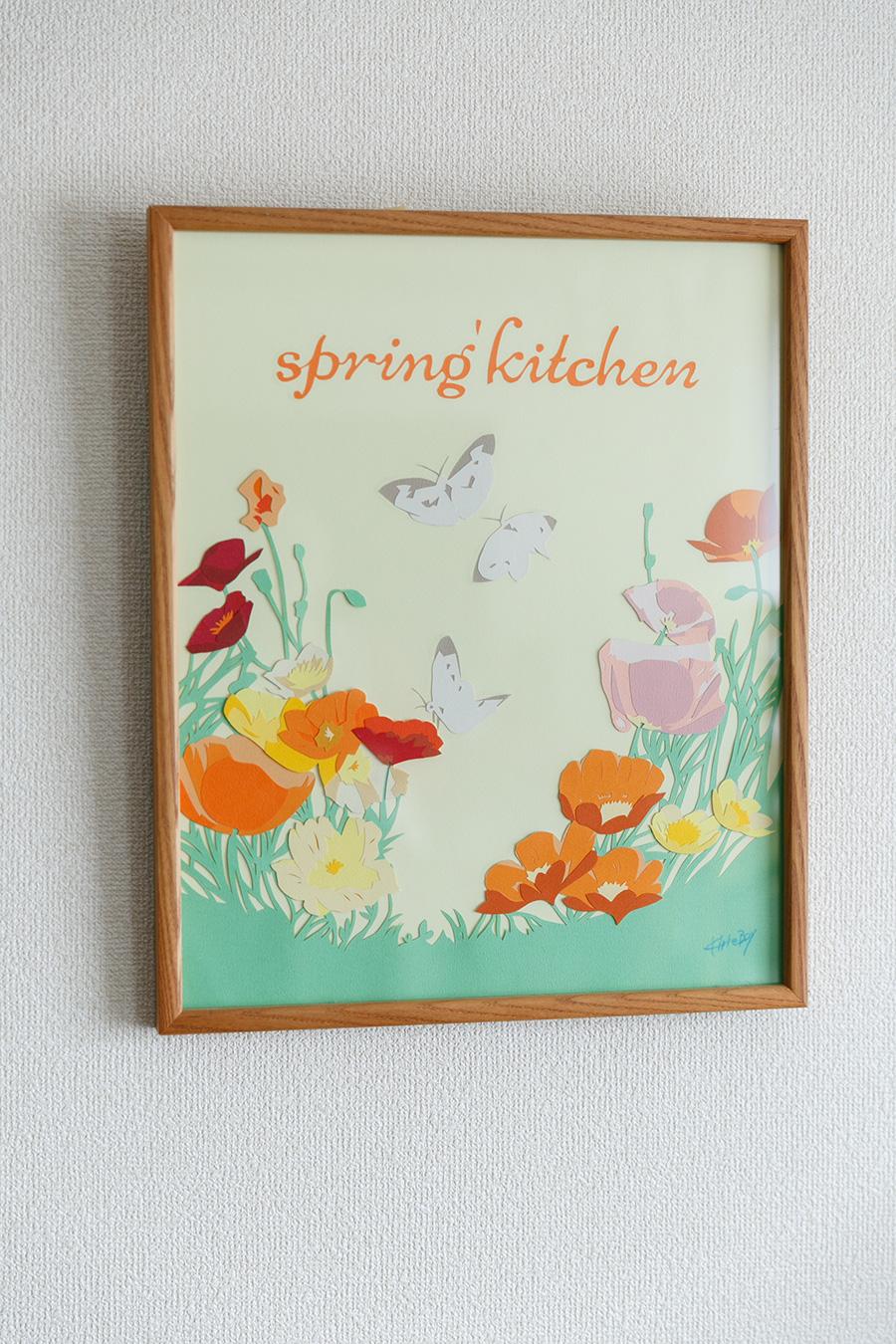 壁にかけられていた素敵な切り絵のボード。「spring' kitchen」という名前には、「春のような心温まるやさしい居場所でありたい」という思いが込められている。